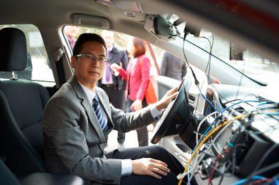 Richard Yu sits in his autonomous research vehicle.