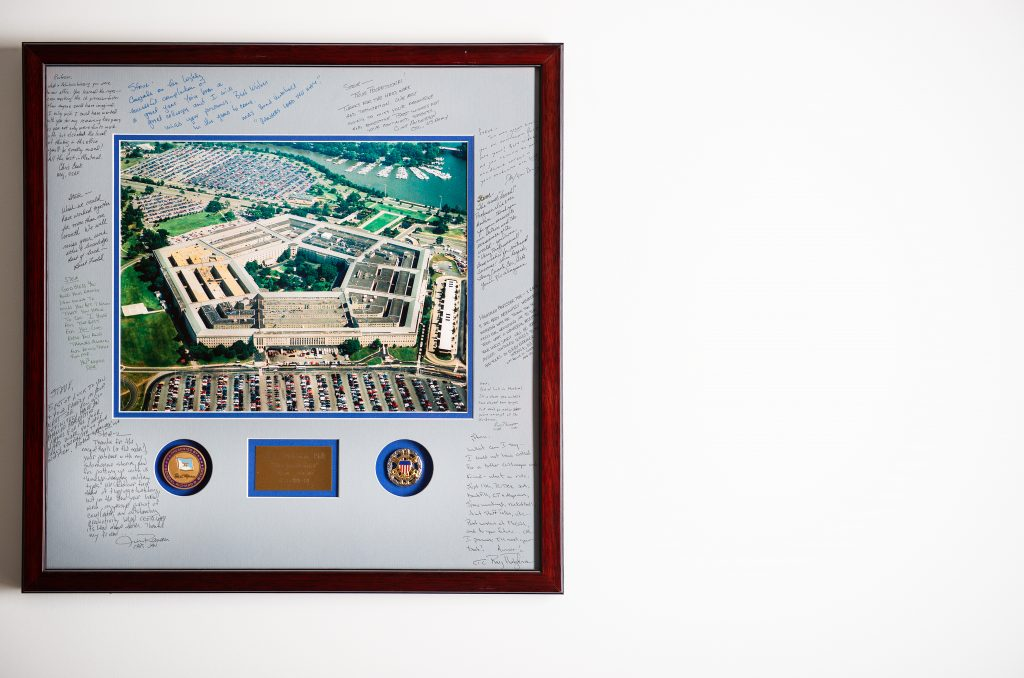 A photo of the US Pentagon signed by unknown people hangs on Steve Saideman's wall