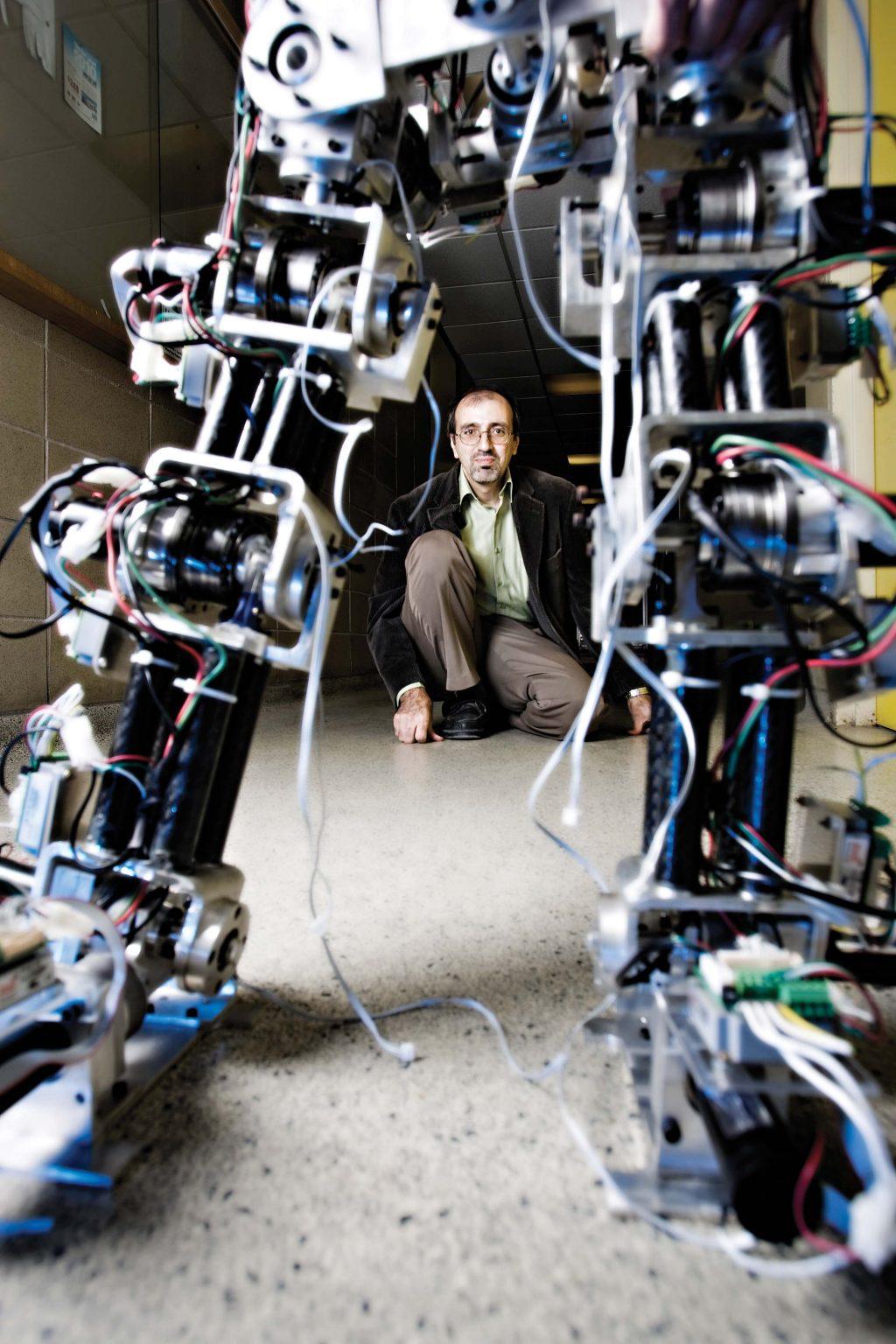 man crouching behind robot legs