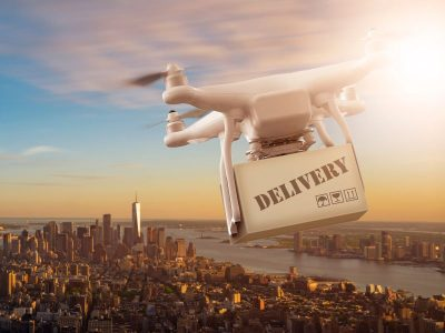 delivery drone flying over a city