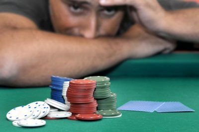 stressed man in a poker tournament