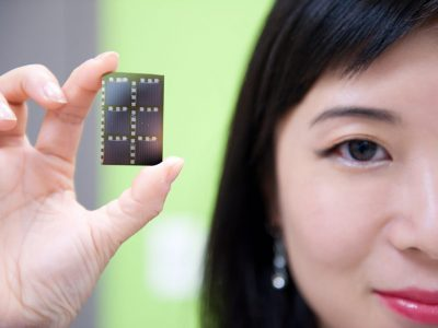 Winnie Ye holding up a piece of chip technology
